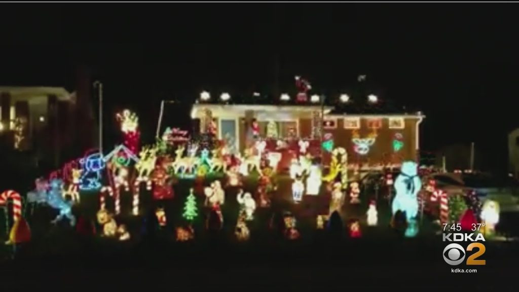 Family Fills Yard With Christmas Lights And Decorations